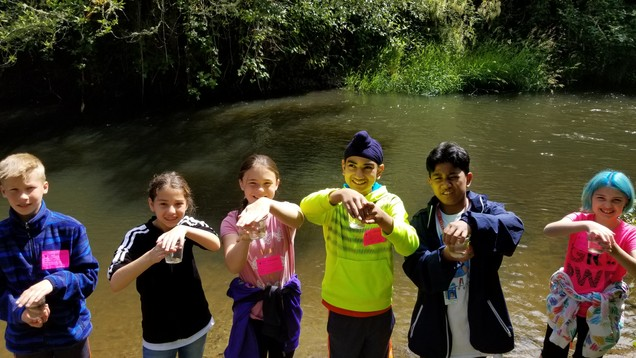 Students on a Fish Release Field Trip